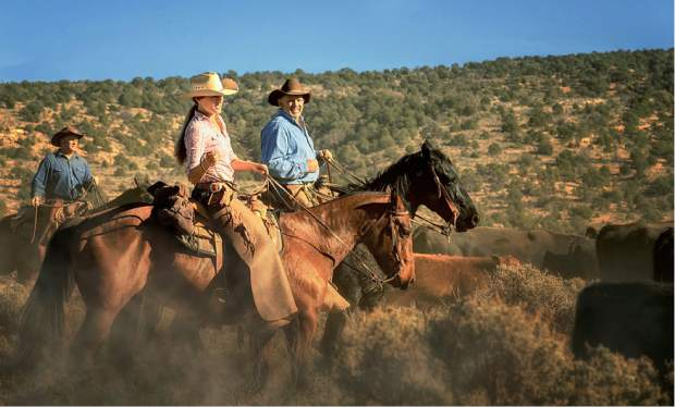 Riders head to the ranch headquarters on the winter range on the Arizona Strip.