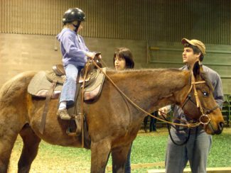 Photo by Jen Eide, SDSUSDSU's Youth Horsemanship Clinics teach students and parents about horse colors and markings, horse health and vitals, horse safety, care, nutrition, parts of the horse and saddle, ground manners and introductory riding skills.