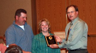 Courtesy photosMike Hook, Jr. (left) and his wife, Jodi, accept the 2009 South Dakota Master Lamb Lamb-to-Finish honor from SDSU Extension Sheep Specialist Jeff Held at the South Dakota Master Lamb Producers Association awards banquet.