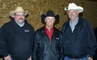 Rick Cameron and Brad Gilbertson from Sherwood, ND, visit with sale host Dennis Price (center) at the Price Family Ranch horse sale. Cameron and Gilbertson both purchased a horse at the sale.