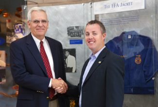Courtesy photoDwight Armstrong, CEO of the National FFA Organization, and Billy Frey, general manager of the Alltech Ag Network, shake hands on a partnership that will see the 2011 National FFA Convention broadcast live online, accessible via computers, iPads, iPhones, Blackberrys, and Androids.