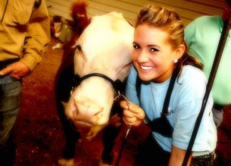 Courtesy photoA special love of Hereford cattle, Calli Pritchard poses with one of her show calves.