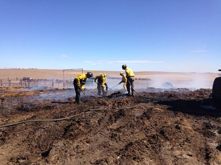 crews fighting fire on ranch