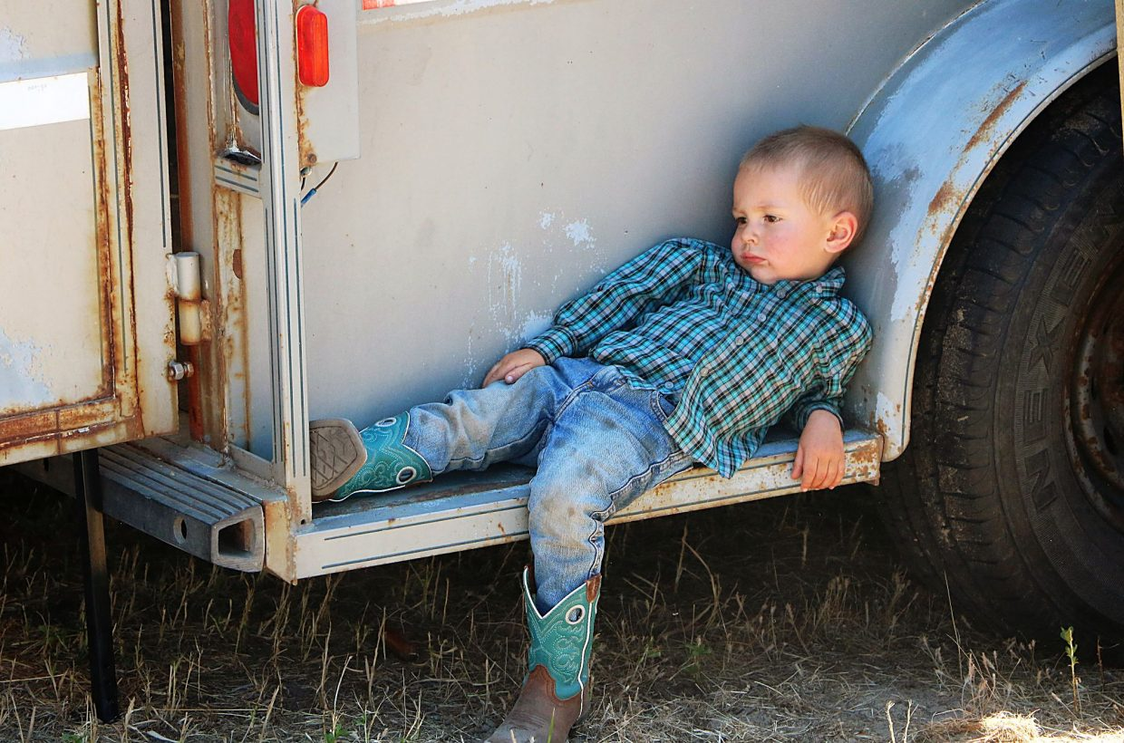 Grady Phipps is the son of Brett and Jordyn Phipps of Whitman, Nebraska. He is two years old and the younger brother of Kaisley, age 6 and Kendall, age 4 who were both competing at the rodeo. While Grady put in a long day, his waiting and cheering was worthwhile when Kaisley took home the all-around buckle and Kendall was named 7th place in the all-around. Photo by Linda Teahon