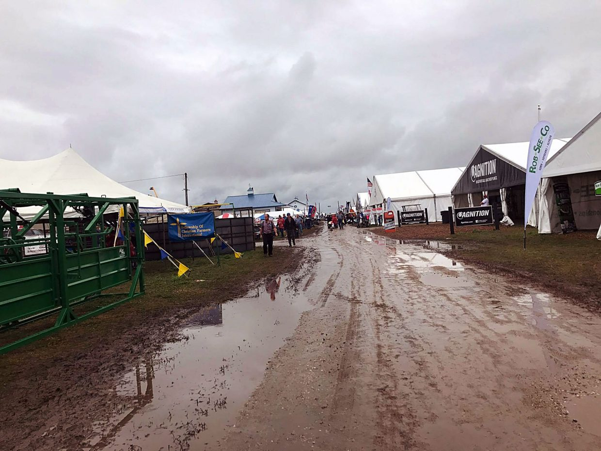 While farmers and ranchers were grateful for the much-needed moisture received in the area over the week, the aisles at DakotaFest were wet and muddy for attendees to navigate.