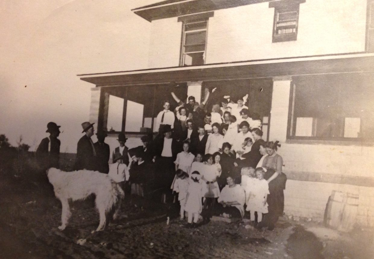 Eatinger family standing in front of the main house in the late 1920s, Ivan the wolf hound in the front. Courtesy photo.