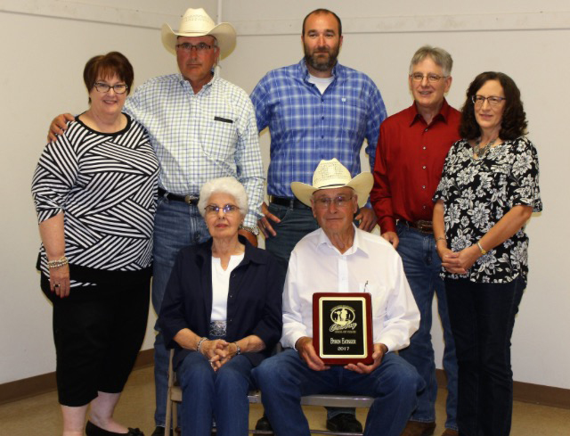 Byron and Mary Eatinger at Byron's induction into the Sandhills Cowboy Hall of Fame, L-R behind them, Roxanna, Wayne, Miles, Dale and Linda Eatinger. Photo compliments of the Sandhills Cowboy Hall of Fame.