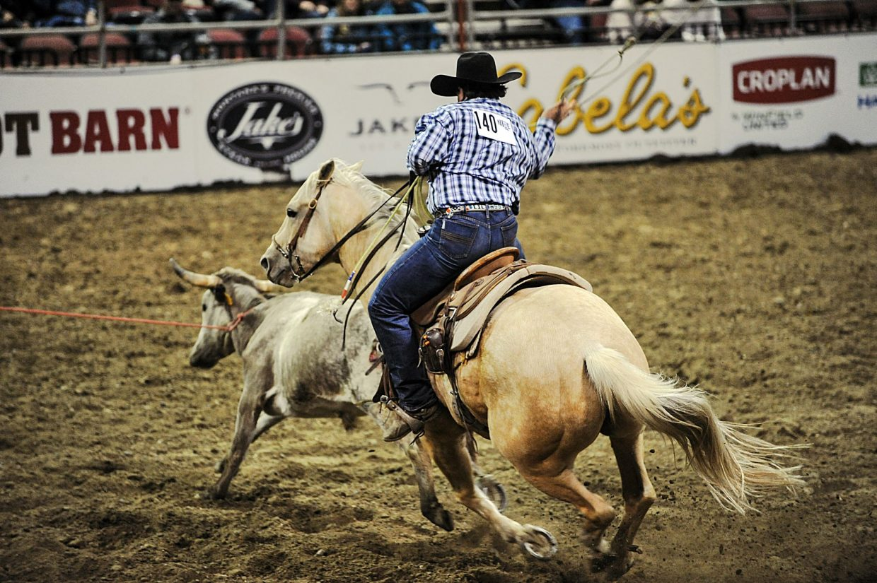 Andrew Wasserburger slings a heel catch in to help gain a first place in team doctoring, which awarded Bootheel 7/Hageman Ranch the NILE Ranch Rodeo championship for the second time.