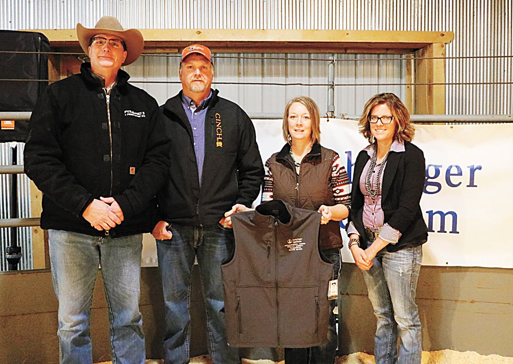 Aaron and Kathy Lau of Corsica, S.D. brought a pen of heifers that took the heavy weight division champion honors. Shown (l to r): John Rehmeir, Boehringer Ingleheim; Aaron and Kathy Lau, and Amanda Kammerer, Black Hills Livestock Show.