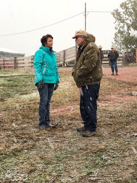 ND Stockmen's Exec Julie Ellingson visits with with Fred Kraft of Enderlin, ND.